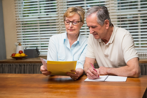older couple doing paperwork